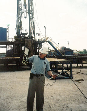 CEO Behr surveys an oil rig for RF hot spots near a broadcast tower