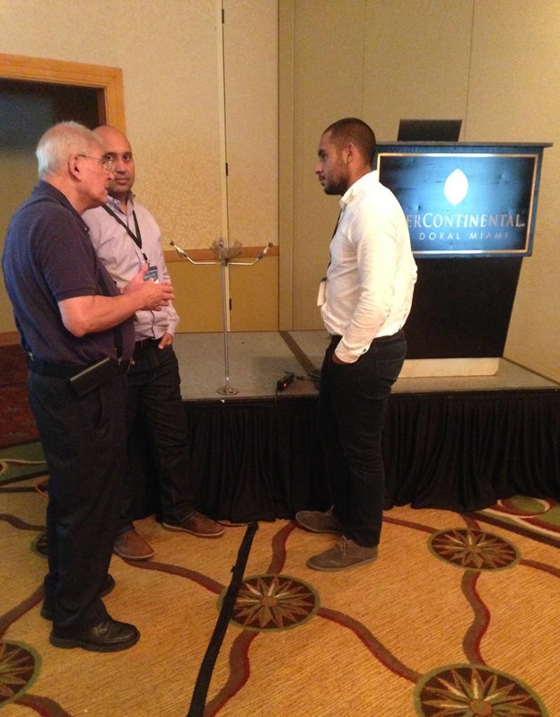 Javier Castillo discusses a lightning protection candelabra with Workshop attendees