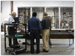 LBA and client engineers adjust a new DRM antenna tuning un it.